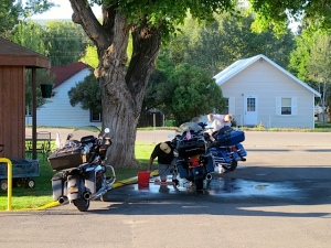 In Meeker, CO. washing the dried mud off the bikes.