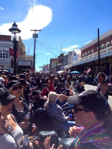 People mingle and line C Street in Virginia City to watch the Street Vibrations scene