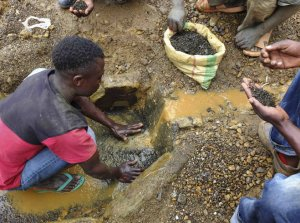 A miner washes tin ore in the Kalimbi mine in the eastern Democratic Republic of Congo.