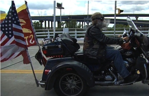 Dave Zien, cruising  with patriotic flags.